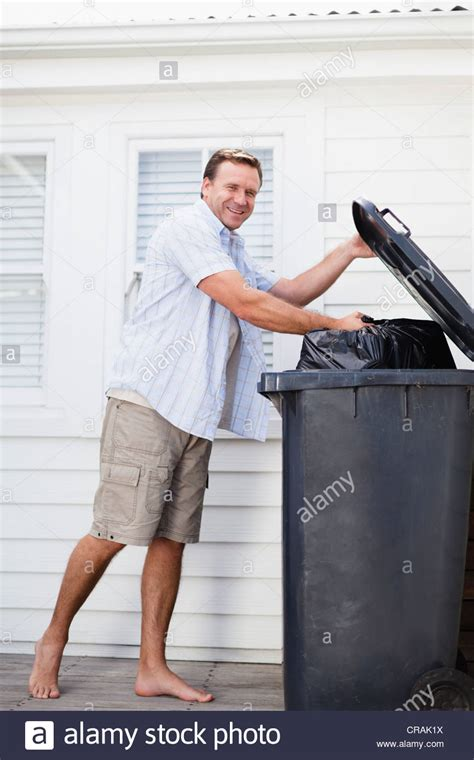 Taking Out The Trash With by Smiling Taking Out Garbage Stock Photo Royalty Free