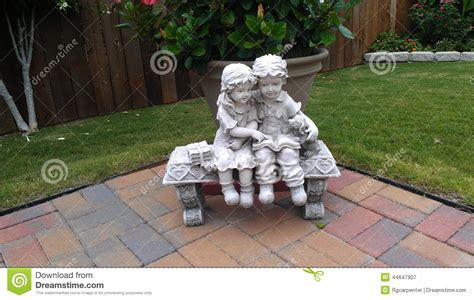 little girl sitting on bench statue statuary friends stock photo image 44647907