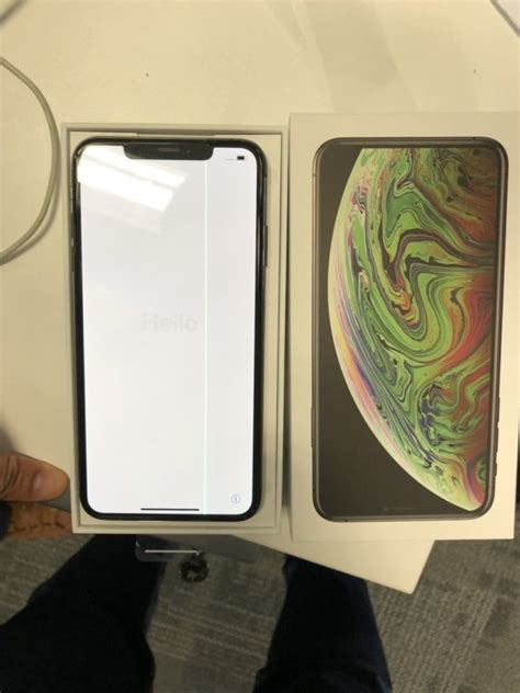 an iphone xs max develops faulty green line display after unboxing