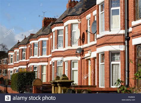 terraced house row of bay fronted terraced houses stock photo