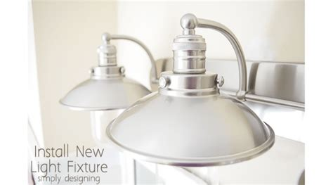 replace bathroom light fixture install a new bathroom light fixture