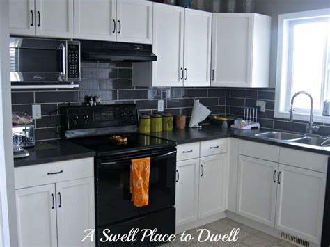 Black Kitchen Cabinets With White Appliances Awesome Black And White Kitchen Cabinet With Black Ceramic Tile Backsplash For Small Kitchen