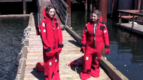 mustang immersion suit putting on a survival suit