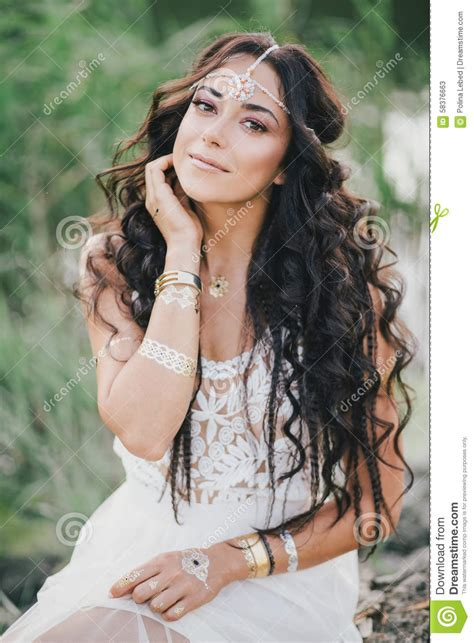 take a look at these stunning carefree bohemian interiors beautiful woman with long curly hair dressed in boho style