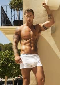 Shirtless dan osborne displays his bulging biceps and toned torso as