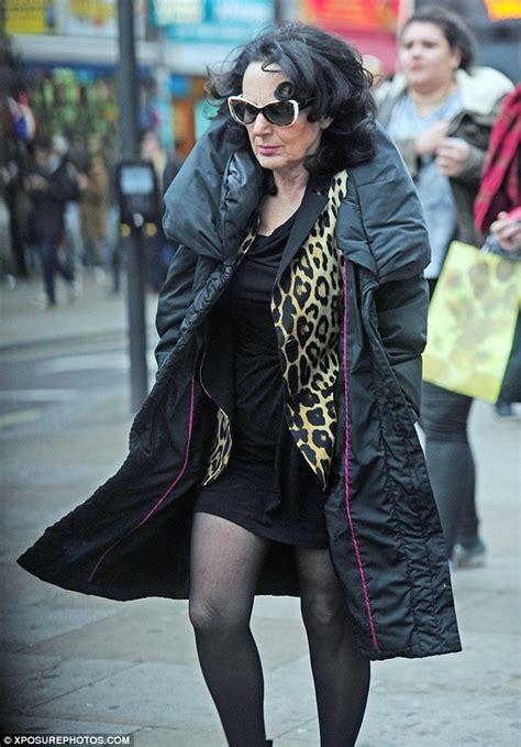 dorien lesley joseph channels  birds   feather character  leopard print coat