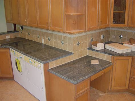 Kitchen Island With Bar Top Quartz Caesarstone Zodiac Silestone Cambria Countertops