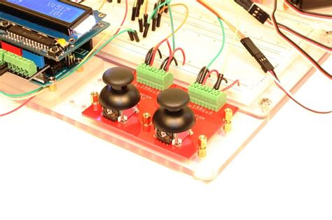 Bdcc Coin Digital two thumbstick jigmods being used to test servos with an