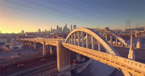 city announces new design for sixth street bridge kcet man in dark hoodie running away in the middle of historic