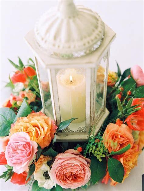 lanterns with flowers centerpieces lantern centerpiece with flower wreath lantern