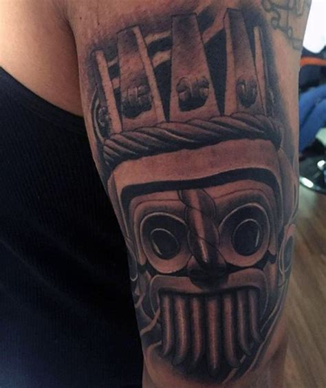 detailed tribal tattoos small black ink detailed tribal statue on shoulder