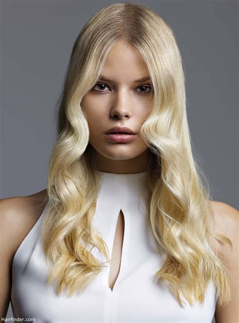 Long blonde hair with waves that surround the face