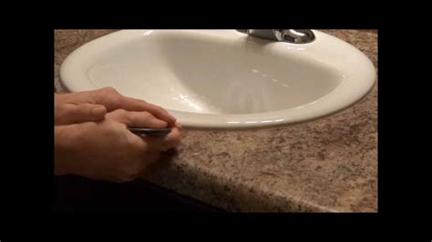 bathroom sink seal how to caulk a sink how a pro does it youtube