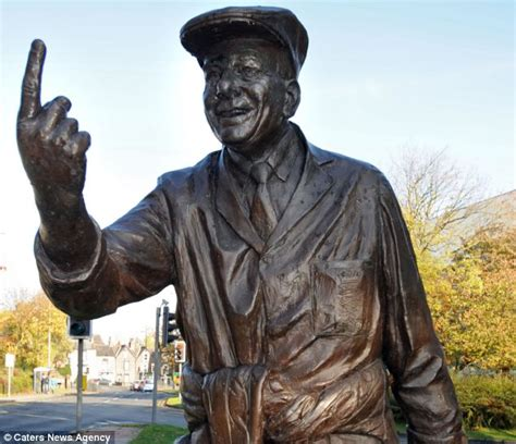 statue of cricket umpire dickie bird is lifted five