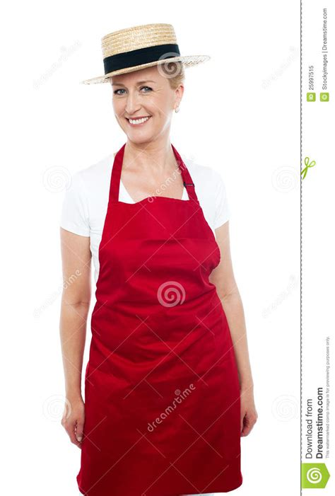 middle age trendy clothing trendy middle aged cheerful cook wearing hat royalty free