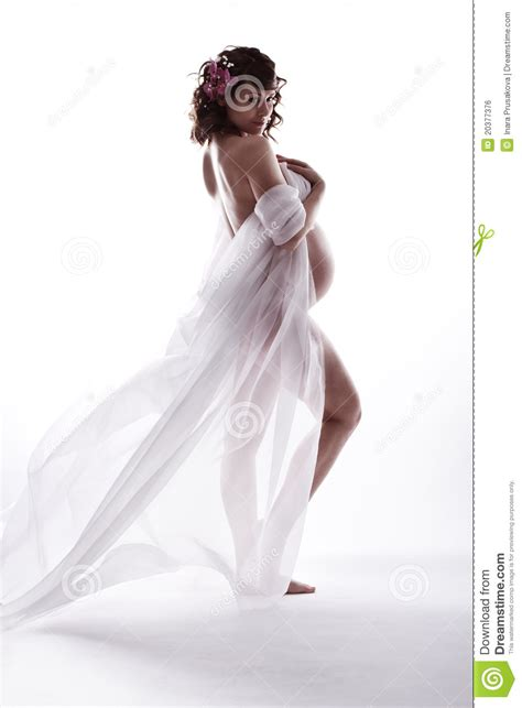 In White in white waving flying dress royalty free