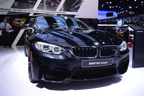 Black Saphire sapphire black bmw m4 looks brilliant at 2014 naias live