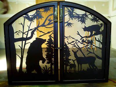 custom fireplace screen featuring deer and bobcat