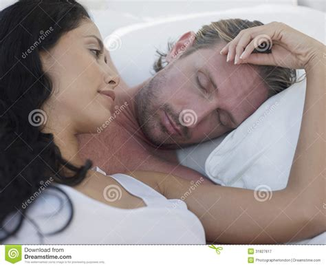 romantic couple in bed images romantic couple in four poster bed royalty free stock
