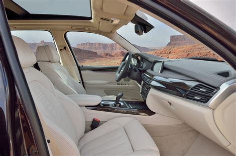 bmw x5 inside 2014 bmw x5 first look motor trend