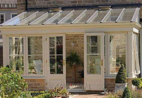 large residential modern sunroom extension backyard
