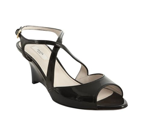 prada black patent leather strappy wedge sandals in black
