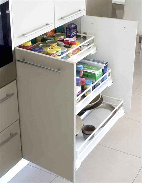 hip white kitchen cabinet with spice organizers kitchen