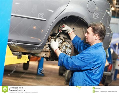 car suspension repair auto mechanic at car suspension repair work royalty free