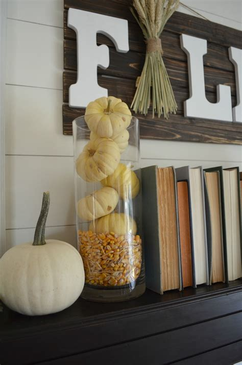 mantles are falling books fall mantel books pumpkins vintage nest