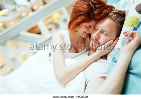 romantic pictures of couples in bed female straddling male stock photos female straddling