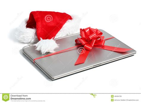 laptop computer christmas gift with a ribbon stock photo