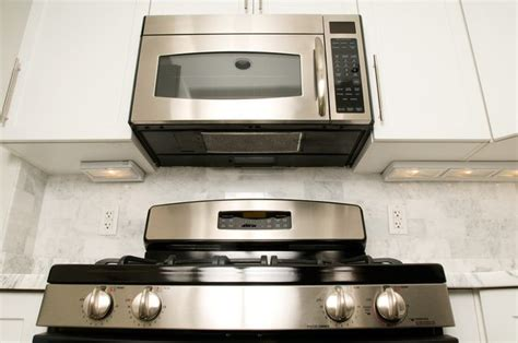 over the range cabinet microwave what is the difference between under the cabinet and over