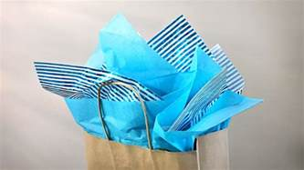 what to put in a gift bag how to put tissue in a gift bag gift wrapping tutorial