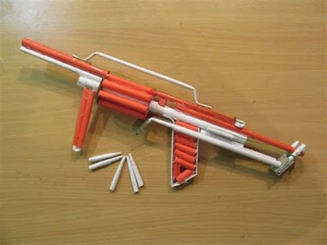 How To Make Paper Bullet - how to make a paper powefull m32 gun that shoots 8 bullets