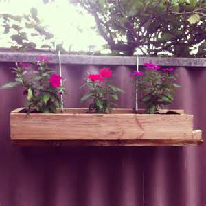 custom diy hanging wood planter boxes using recycled wood