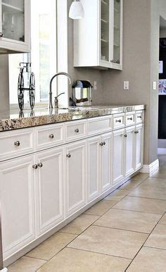 kitchen floor tile ideas tile surfaces updating a cozy 36 quot upper cabinets with 6 quot stacked molding 8 foot