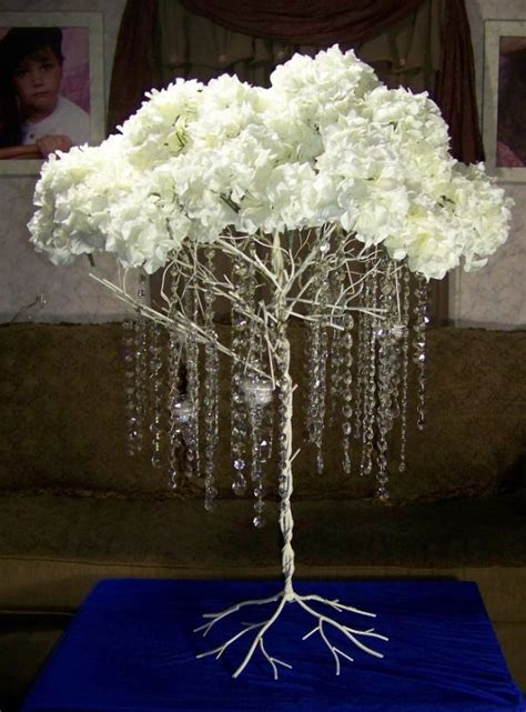 metal tree with hanging crystals hydrangeas and lites
