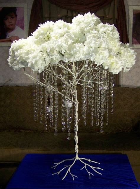 Metal tree with hanging crystals, hydrangeas and lites