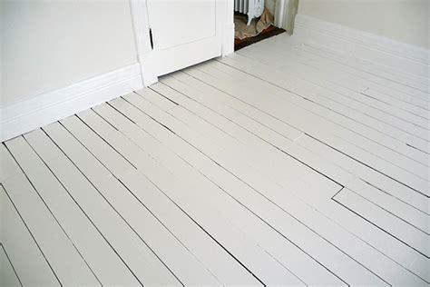 White Painted Wood Floors by White Painted Floor Back Room Door Sixteen