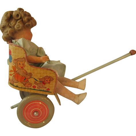 composition doll tin ohio tin doll cart pull and composition