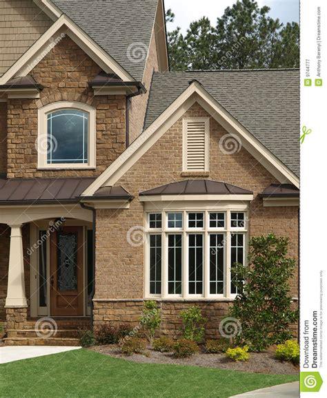 luxury model home exterior front door bay window stock