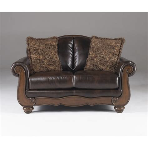 ashley barcelona faux leather loveseat in antique 5530035
