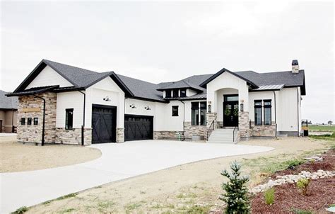 white ranch house with black garage door modern rustic white farmhouse black doors black trim