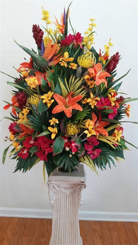large tropical floral arrangement foyer table hotel