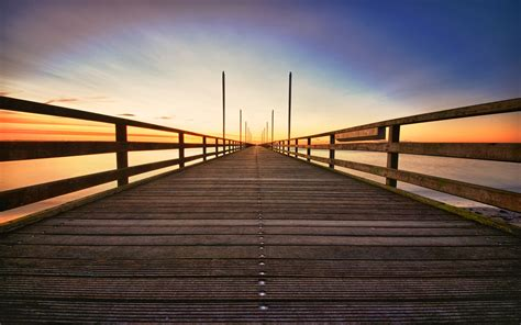 download landscapes bridges wallpaper 2560x1600 download wallpaper 2560x1600 wooden bridge sunrise sea