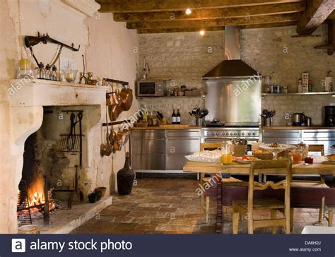 french country kitchen with fireplace kitchens in white pinterest lit fire in fireplace in country kitchen with rustic