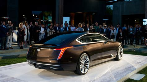 asian person on new cadilaic comeercial cadillac escala oscars ad driving people into dealerships