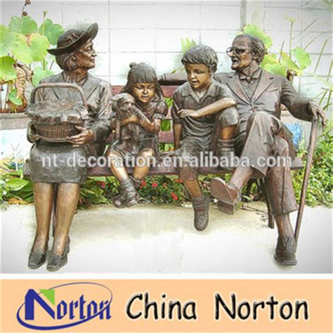 little girl sitting on bench statue grandfather grandmother and little boy girl and dog