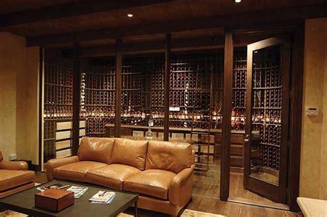 basement wine room living area glass enclosed mahogany wine cellar rustic wine cellar by wine cellar innovations