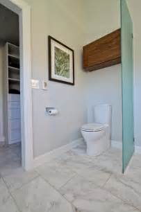 Kids Bathroom Tile - glass partition toilet area with walnut storage cabinet over toilet contemporary bathroom